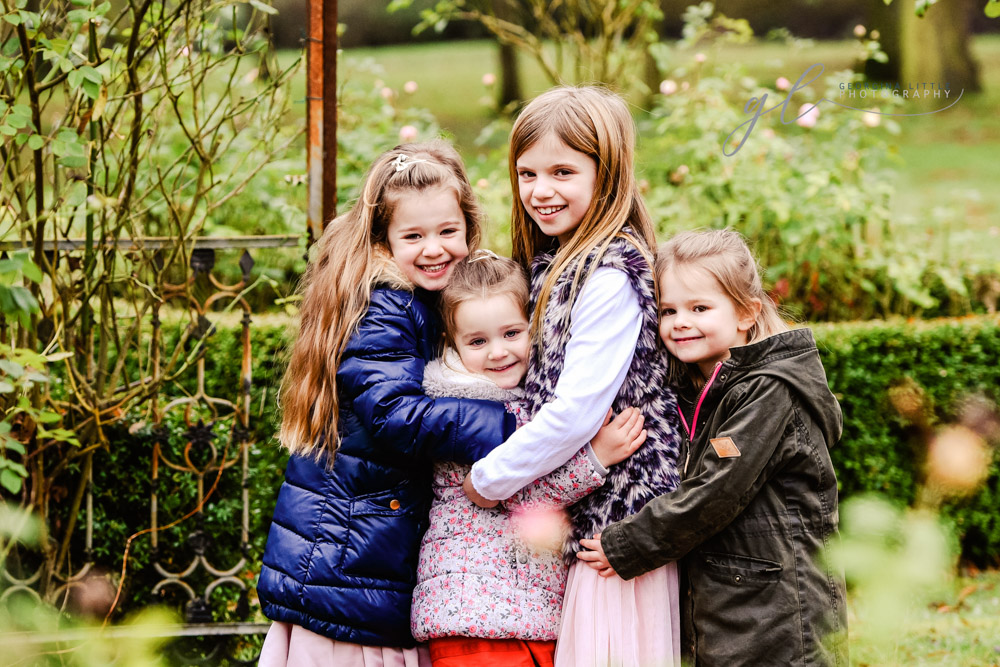 Winter outdoor family photoshoot with children in suffolk